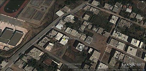 بناية من 04 طوابق تحتوي على 07 سكنات و 03 محلات للبيع